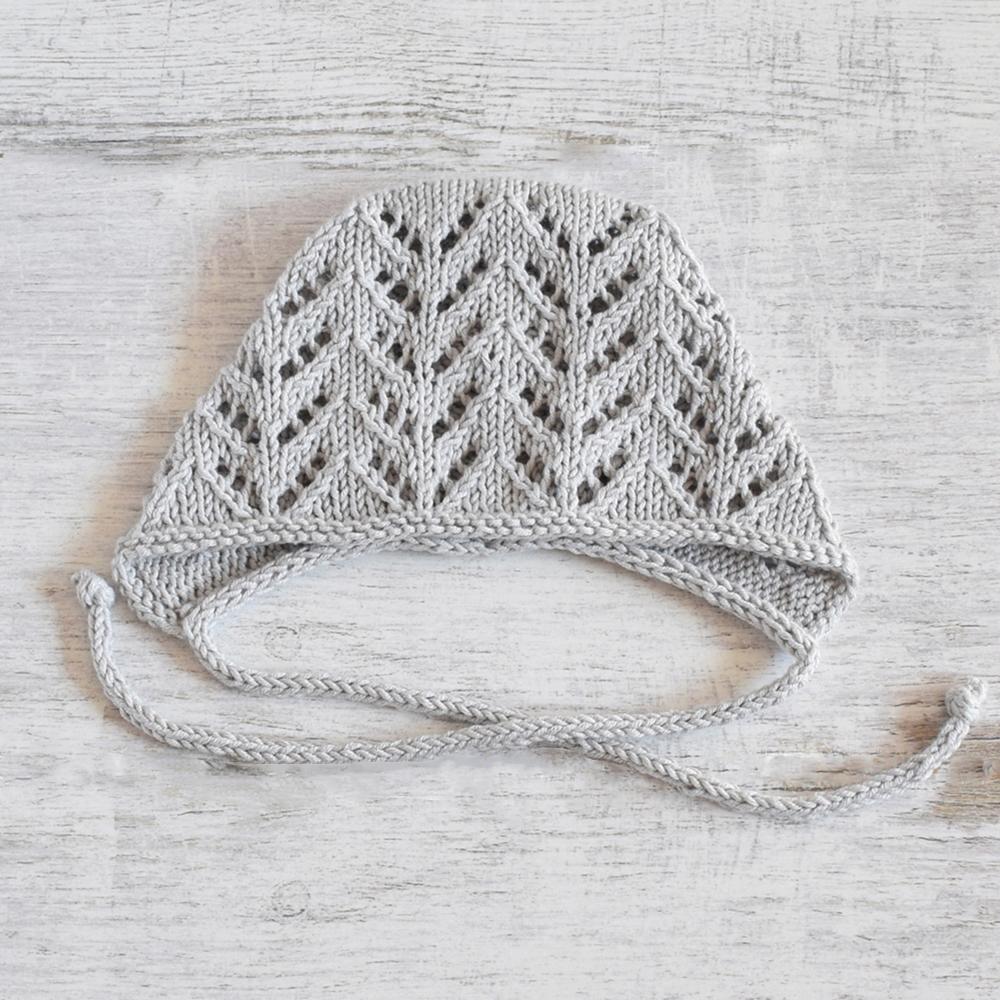 Ażurowa czapka niemowlęca - robiona na drutach - ALOM